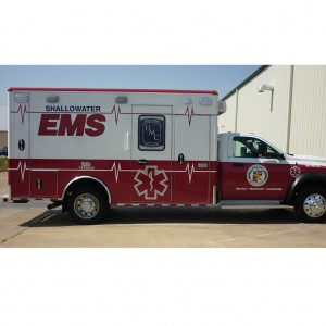 Emergency vehicle with cast vinyl and reflective vinyl