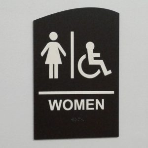 Women restroom braille sign with pictogram